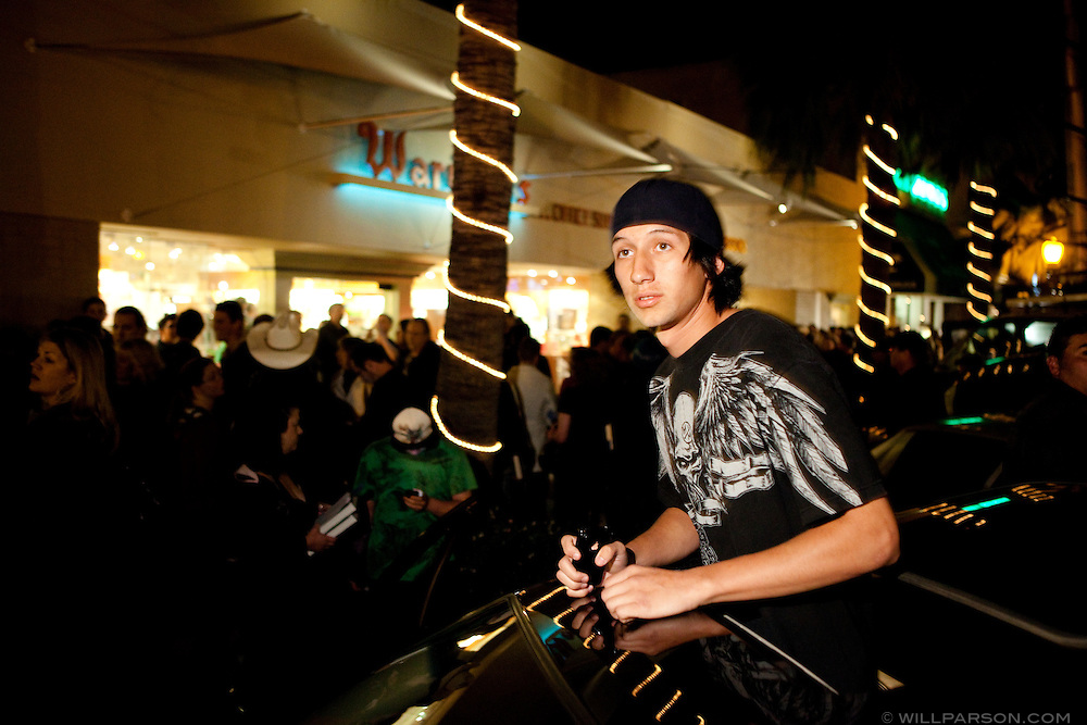 Michael Morales watched the crowd from the sunroof of a parked car that was blaring Ozzy Osbourne songs on Girard Avenue in front of Warwick's bookstore in La Jolla.