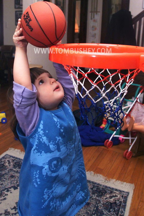 Annie Bushey plays basketball the day after her second birthday. Digital photo. Feb. 18, 2001.