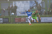 Forest Green Rovers Marcus Kelly(10) is tackled by Dovers Ricky Modeste during the Vanarama National League match between Forest Green Rovers and Dover Athletic at the New Lawn, Forest Green, United Kingdom on 17 December 2016. Photo by Shane Healey.