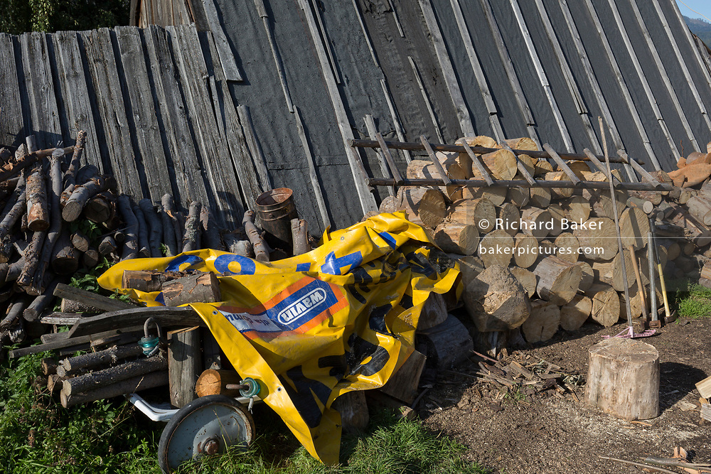 Logs and covered equipment outside a traditional Polish mountain shepherd's hut, on 21st September 2019, in Jaworki, near Szczawnica, Malopolska, Poland.