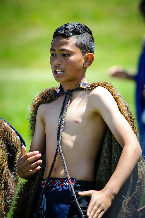 WELLINGTON, NEW ZEALAND - November 30:  Young Boy Performs with a Maori Kapa Haka group during the Hutt River Festival November 30, 2014 in Ewan Bridge, Hutt City, New Zealand.  Interislander River Festival.  (Photo by Mark Tantrum/ real-people.co.nz)