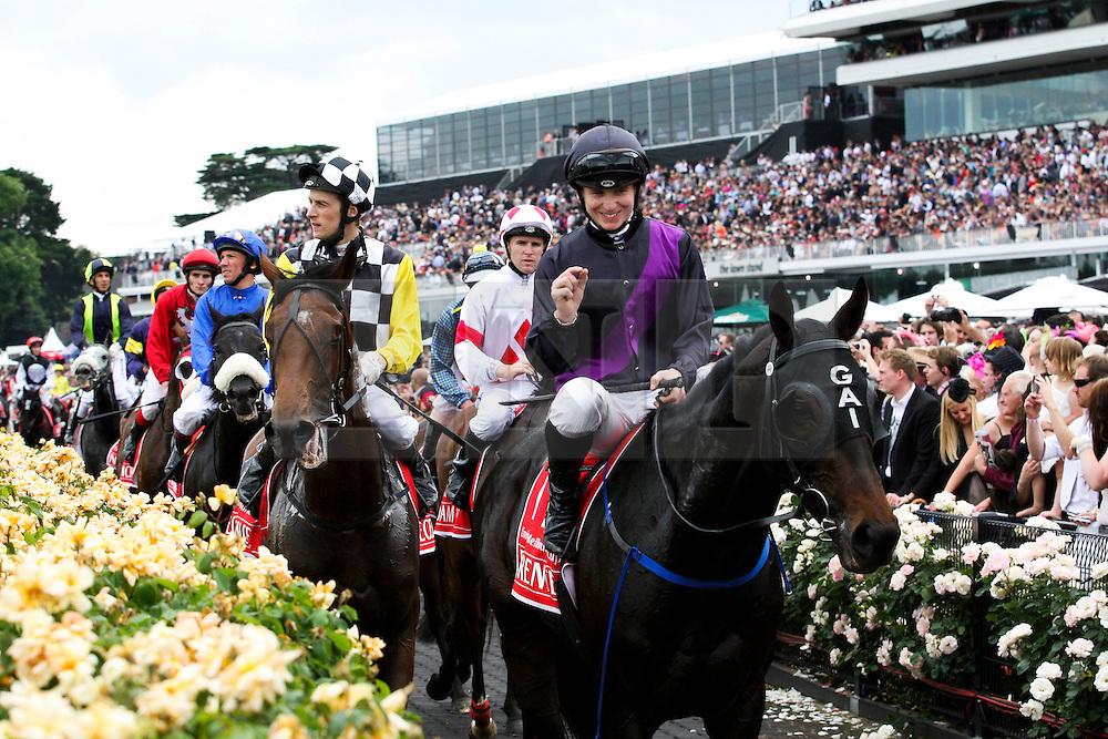 © Licensed to London News Pictures. 06/11/2012. Fiorente ridden by jockey James Mc Donald, makes a gesture showing how close he was after finishing second during the Emirates Melbourne Cup at the Flemington Racecourse, Melbourne. Photo credit : Asanka Brendon Ratnayake/LNP