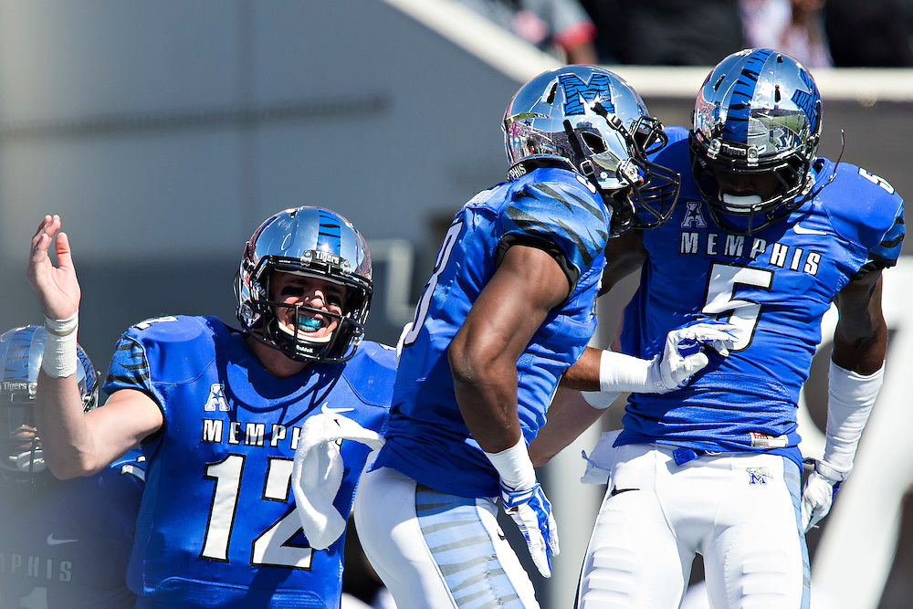 MEMPHIS, TN - OCTOBER 17:  Paxton Lynch #12, Anthony Miller #3 and Mose Frazier #5 of the Memphis Tigers celebrate after a touchdown against the Ole Miss Rebels at Liberty Bowl Memorial Stadium on October 17, 2015 in Memphis, Tennessee.  The Tigers defeated the Rebels 37-24.  (Photo by Wesley Hitt/Getty Images) *** Local Caption ***  Paxton Lynch; Mose Frazier; Anthony Miller