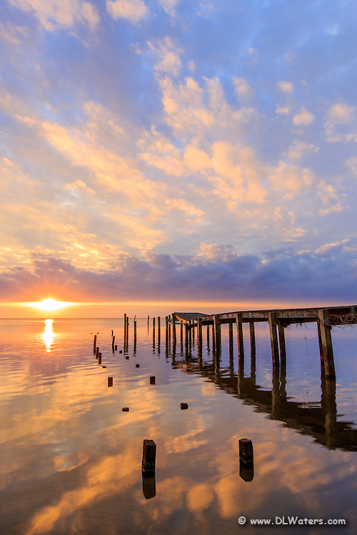 Storm damaged pier on the Albemarle Sound photographed at sunset.