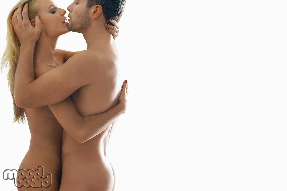 Naked couple embracing on white background