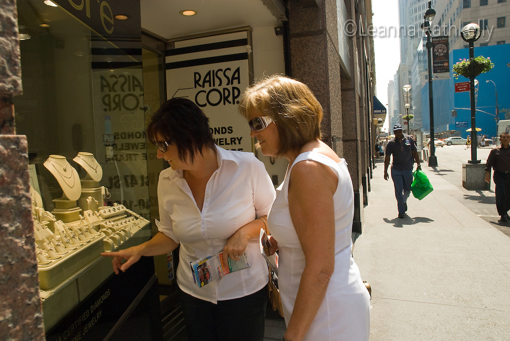 A pair of mature ladies window-shop in the Diamond District of New York City, NY