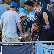 Medical staff (Right) assist a fan (middle) in the stands after being hit by a ball prior to the match between The Houston Dynamo and The Philadelphia Union Saturday Aug. 6, 2011 at PPL Park in Chester PA...The News Journal/SAQUAN STIMPSON