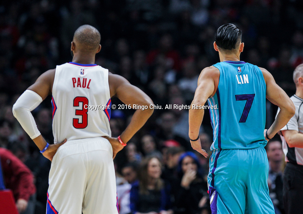 Los Angeles Clippers Chris Paul and Charlotte Hornets Jeremy Lin stand together during the NBA basketball game against Charlotte Hornets in Los Angeles, the United States, Jan. 9, 2016. Los Angeles Clippers won 97-83. (Xinhua/Zhao Hanrong)(Photo by Ringo Chiu/PHOTOFORMULA.com)<br /> <br /> Usage Notes: This content is intended for editorial use only. For other uses, additional clearances may be required.