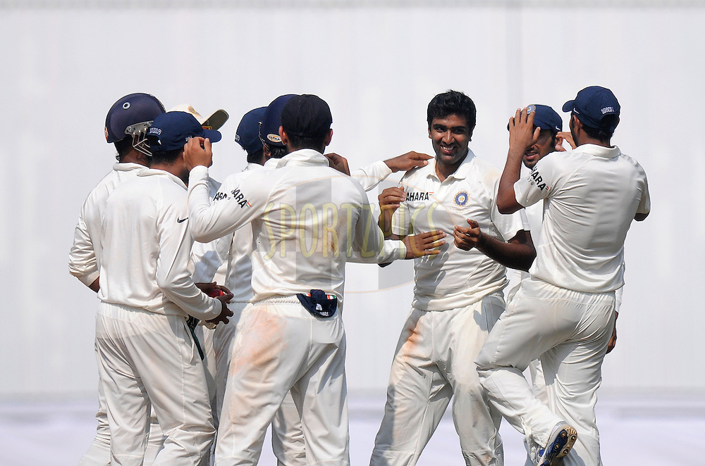 Ravichandran AShwin of India celebrates the wicket of Darren Sammy captain of West Indies during day one of the second Star Sports test match between India and The West Indies held at The Wankhede Stadium in Mumbai, India on the 14th November 2013<br /> <br /> This test match is the 200th test match for Sachin Tendulkar and his last for India.  After a career spanning more than 24yrs Sachin is retiring from cricket and this test match is his last appearance on the field of play.<br /> <br /> Photo by: Pal PIllai - BCCI - SPORTZPICS<br /> <br /> Use of this image is subject to the terms and conditions as outlined by the BCCI. These terms can be found by following this link:<br /> <br /> http://sportzpics.photoshelter.com/gallery/BCCI-Image-Terms/G0000ahUVIIEBQ84/C0000whs75.ajndY