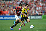 10.03.2013 Sydney, Australia. Wellingtons forward Corey Gsmeiro amd Wanderers Croatian midfielder Mateo Poljak in action during the Hyundai A League game between Western Sydney Wanderers and Wellington Phoenix FC from the Parramatta Stadium. The Wanderers won 2-1.