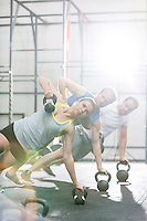 Confident people exercising in crossfit gym