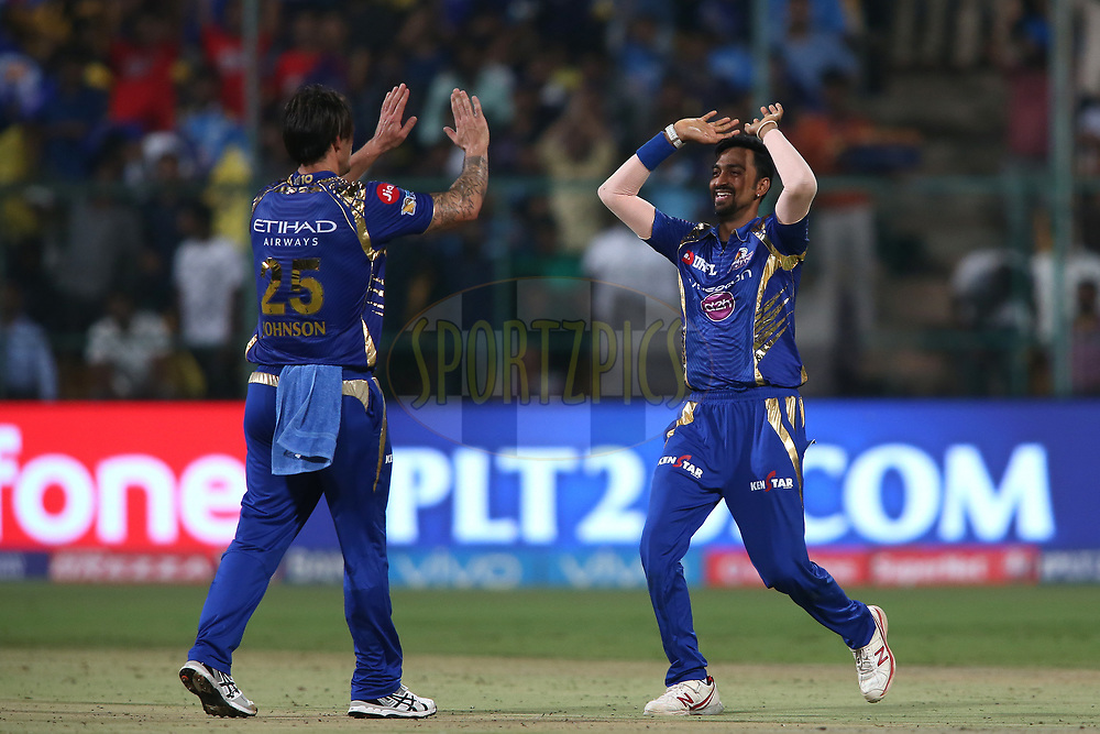Mitchell Johnson of the Mumbai Indians is congratulated by Krunal Pandya of the Mumbai Indians for getting Nathan Coulter-Nile of the Kolkata Knight Riders wicket during the 2nd qualifier match of the Vivo 2017 Indian Premier League between the Mumbai Indians and the Kolkata Knight Riders held at the M.Chinnaswamy Stadium in Bangalore, India on the 19th May 2017<br /> <br /> Photo by Shaun Roy - Sportzpics - IPL