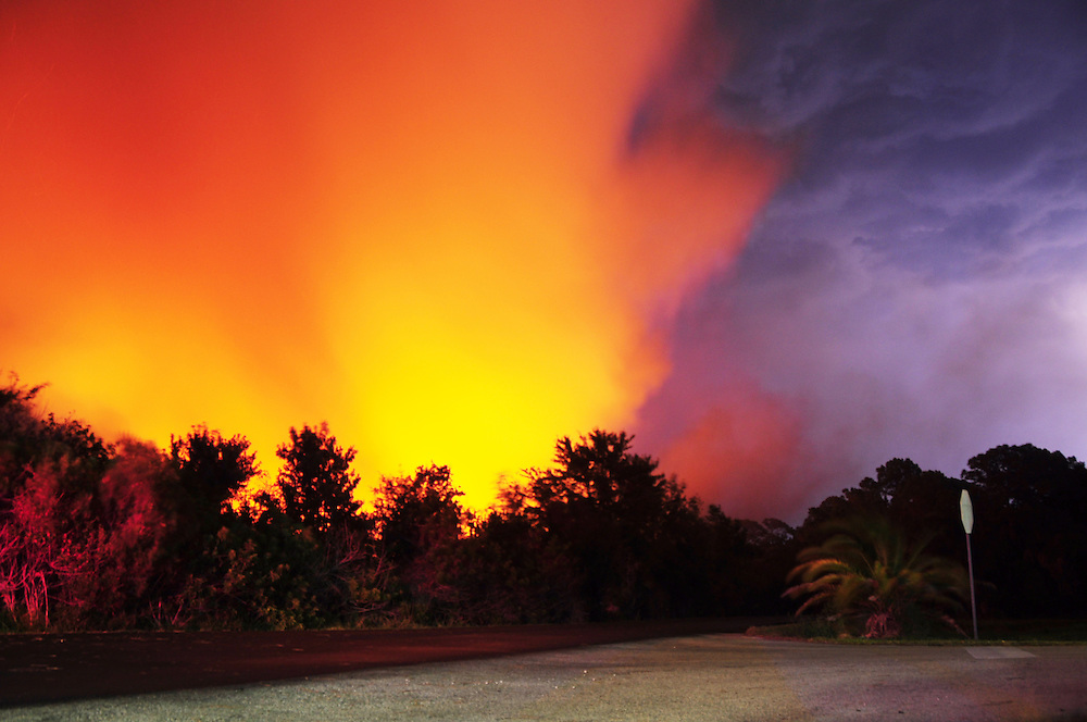 Andrew Knapp, FLORIDA TODAY -- June 14, 2011 -- Lightning flashes behind a wildfire sparked Tuesday evening by lightning just west of the Devereux Florida facility at Murrell and Wickham roads in Viera.