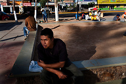Migrants pass the time in the main plaza in Altar, Sonora.  Altar is the starting point for many migrants' journeys to the US. In Altar they find guides and coyotes to take them across the border.  The town's economy is nearly entirely dependent on the migrants. Recently drug cartels have become involced in the smuggling of people, using the same routes as the drugs and charging the migrants an exit tax to leave the country.