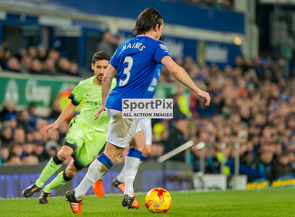 Everton defender Leighton Baines moves the ball out of defence in the Football League cup semi-final first leg at Goodison Park, Liverpool