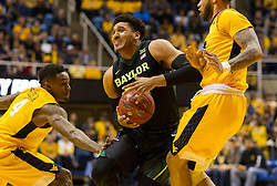Feb 6, 2016; Morgantown, WV, USA; Baylor Bears guard Ishmail Wainright (24) is guarded by West Virginia Mountaineers forward Esa Ahmad (23) during the first half at the WVU Coliseum. Mandatory Credit: Ben Queen-USA TODAY Sports