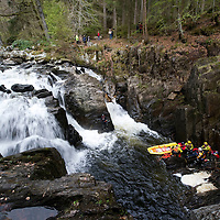 Tayside Fire & Rescue Water Rescue Exercise, The Hermitage, Dunkeld, Perthshire...04.05.10<br /> Record reporter James Moncur with members of Tayside Fire & Rescue, Tayside Mountain Recue and Tayside Police Search & Rescue prepare to load the casulaty onto the Rescue Sled before floating down the River Braan<br /> Picture by Graeme Hart.<br /> Copyright Perthshire Picture Agency<br /> Tel: 01738 623350  Mobile: 07990 594431