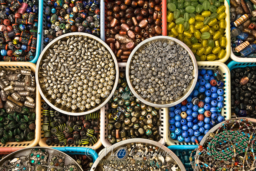 Colorful glass beads arranged in boxes and displayed for sale on the bank of Ganga River in Varanasi.<br /> (Photo by Matt Considine - Images of Asia Collection)