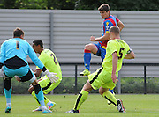 Jake Gray has an effort blocked during the U21 Professional Development League match between Crystal Palace U21s and Huddersfield U21s at Imperial Fields, Tooting, United Kingdom on 7 September 2015. Photo by Michael Hulf.