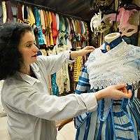 VENICE, ITALY - JANUARY 20:  Anna Briggi of the historic atelier Pietro Longi examines a costume on January 20, 2012 in Venice, Italy. This is one of the busiest periods of the year for the atelier as the next few weeks the streets and canals of Venice will be filled with people attending the carnival, wearing highly-decorative and imaginative carnival costumes and masks.