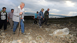 Early morning pilgrims make their way up Croagh Patrick for the annual pilgrimage yesterday.<br />