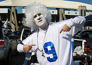 IRVING, TX - JANUARY 13: A Cowboys fan wearing a white wig and jersey of quarterback Tony Romo #9 of the Dallas Cowboys gets fired up while tailgating for the New York Giants NFC Divisional Playoff Game against the Dallas Cowboys at Texas Stadium on January 13, 2008 in Irving, Texas. ©Paul Anthony Spinelli