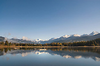 Mountains are reflected in Alta Lake, autumn day in Whistler, BC Canada