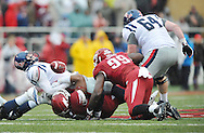 Ole Miss Rebels quarterback Bo Wallace (14) fumbles as he is tackled by Arkansas Razorbacks defensive tackle Darius Philon (91) as Arkansas Razorbacks defensive end Brandon Lewis (99) and Ole Miss Rebels offensive lineman Ben Still (64) move in at Donald W. Reynolds Razorback Stadium in Fayetteville, Ark. on Saturday, November 22, 2014.