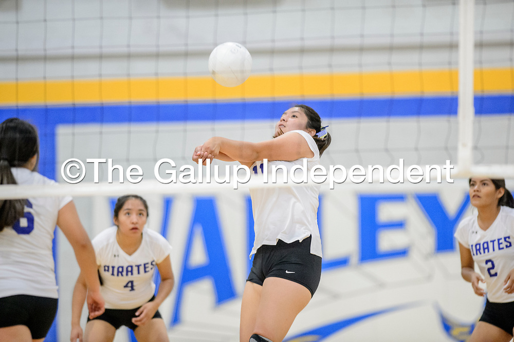 Valley Sanders Pirate Tilda Hubbell (11) lines up a serve return to the Window Rock Scouts in Sanders Tuesday.