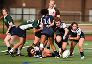 Belmont's players chase down a loose ball during the game against the Needham High team at Harris Field in Belmont, May 23, 2017.   [Wicked Local Photo/James Jesson]
