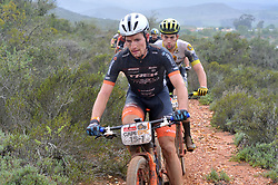 WORCESTER, SOUTH AFRICA - MARCH 21: Fabian Rabensteiner during stage three's 122km from Robertson to Worcester on March 21, 2018 in Cape Town, South Africa. Mountain bikers from across South Africa and internationally gather to compete in the 2018 ABSA Cape Epic, racing 8 days and 658km across the Western Cape with an accumulated 13 530m of climbing ascent, often referred to as the 'untamed race' the Cape Epic is said to be the toughest mountain bike event in the world. (Photo by Dino Lloyd)