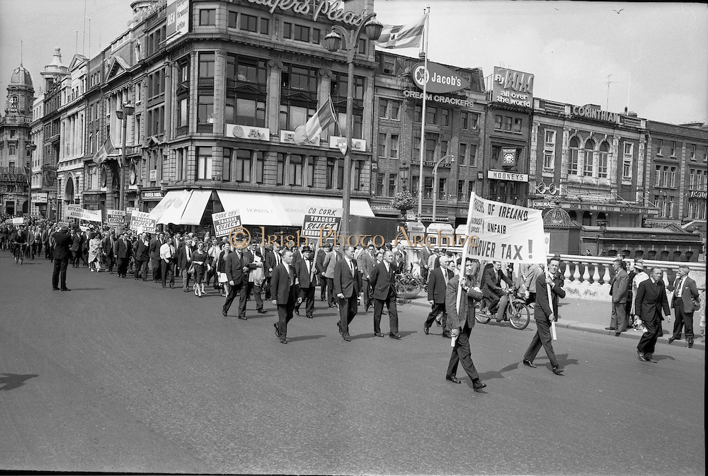 03/07/1963<br /> 07/03/1963<br /> 03 July 1963<br /> RGDATA Turnover Tax Protest March in Dublin. Picture shows RGDATA delegates who marched through Dublin to Government Buildings to present their protest to against the proposed Turnover Tax to the Minister for Finance crossing O'Connell Bridge led by Cork members.