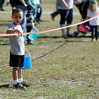 Thomas Wells | BUY at PHOTOS.DJOURNAL.COM<br /> Patera McGee, 3, didn't waste anytime and grabbed his spot along the rope of his age division at Saturday's annual Easter Egg Hunt.