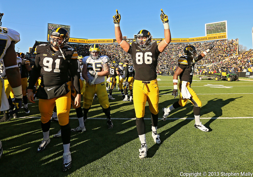 November 23 2013: Iowa Hawkeyes tight end C.J. Fiedorowicz (86) celebrates after the end of the NCAA football game between the Michigan Wolverines and the Iowa Hawkeyes at Kinnick Stadium in Iowa City, Iowa on November 23, 2013. Iowa defeated Michigan 27-24. Iowa defeated Michigan 24-21.