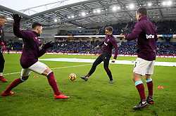 """West Ham United's Jordan Hugill (centre) warming up  during the Premier League match at the AMEX Stadium, Brighton. PRESS ASSOCIATION Photo. Picture date: Saturday February 3, 2018. See PA story SOCCER Brighton. Photo credit should read: Steven Paston/PA Wire. RESTRICTIONS: EDITORIAL USE ONLY No use with unauthorised audio, video, data, fixture lists, club/league logos or """"live"""" services. Online in-match use limited to 75 images, no video emulation. No use in betting, games or single club/league/player publications."""