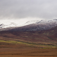 Sheefry Hills with storm clouds and snow. County Mayo, Ireland.