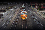 A BNSF train cruises south near  the Elliott Bay Trail at Centennial Park in Seattle.  Shot from a pedestrian overpass near the waterfront. (Ellen M. Banner / The Seattle Times)