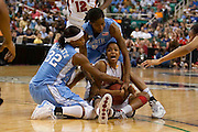North Carolina's Rashanda McCants (32) and Jessica Breland (51) tie up Maryland's Marah Strickland during Maryland's 95 - 84 victory of North Carolina in the 2009 ACC Women's Basketball Tournament being held at the Greensboro Coliseum in Greensboro, North Carolina.  (Photo by Mark W. Sutton)