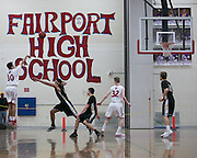 Matthew Keenan of Fairport shoots a 3-pointer during a game against Greece Athena at Fairport High School on Saturday, January 3, 2015.