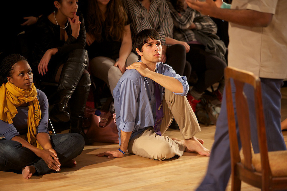 "Who/Nani/Qui, A Concordia Theatre Department production...""Who/Nani/Qui explores social, cultural, artistic, linguistic, ideological and other commonalities and differences. Through the creative process, under the direction of Rachael Van Fossen, students and a group of guest artists have become artist-anthropologists, studying themselves and each other."". .Van Fossen said: ""In developing the piece, our ensemble played with the notion that we can perform in 'character' as each other. Through these performances we were able to uncover both differences and commonalities that go beyond the more obvious markers of identity."". .Who/Nani/Qui includes dance, song and storytelling. Performances range from the improvisational gestural and physical, to highly theatricalized and scripted narratives crossing conventional identity distinctions...Written and directed by Rachael Van Fossen and created with the ensemble and members of the Collectif MOYO..Choreography by Junior Padingani and Kens Mukendi."