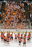 """2010/3/27 - The RIT Men's Hockey team salutes the student section (dubbed the """"Corner Crew"""") after defeating Denver at the East Regional of the NCAA Tournament. The following day, RIT defeated the University of New Hampshire to advance to the Frozen Four."""