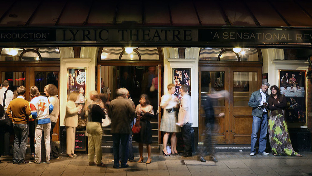 People outside lyric theatre in London at night