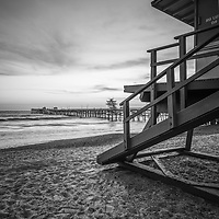 San Clemente lifeguard tower one and pier black and white photo. San Clemente is a popular coastal town in Orange County Southern California in the United States of America. Copyright ⓒ 2017 Paul Velgos with all rights reserved.