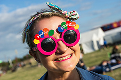 A festivagoer celebrating her birthday at the Brownstock Festival in Essex.