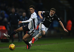 Antonee Robinson of Bolton Wanderers (L) and Tom Cairney of Fulham in action - Mandatory by-line: Jack Phillips/JMP - 10/02/2018 - FOOTBALL - Macron Stadium - Bolton, England - Bolton Wanderers v Fulham - English Football League Championship