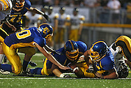 Benton Community's Jacob Bierschenk (75) recovers a fumble as Ben Twedt (10) and Drew Kithcart (53) look on during the first half of their game between Vinton-Shellsburg and Benton Community at Benton Community High School in Van Horne on Friday evening, August 24, 2012.