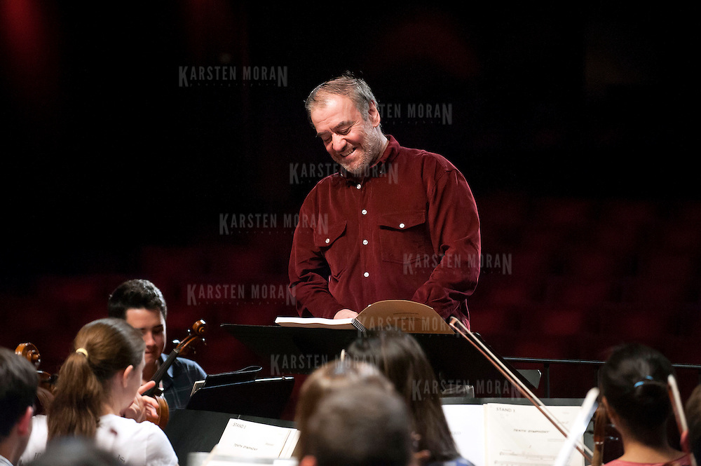 July 9, 2013 - Purchase, NY : Russian conductor Valery Gergiev smiles as he takes the stage to lead the National Youth Orchestra of the United States of America in  rehearsal at SUNY Purchase's Performing Arts Center in Westchester on Tuesday afternoon. The Orchestra, a new project of Carnegie Hall's Weill Music Institute, is comprised of musicians aged 16-19, hand-picked from across the country. The program -- and orchestra -- will kick off its inaugural season with a performance at SUNY Purchase on Thursday evening, and then head off to perform in Washington DC,  Moscow, St. Petersburg, and London. CREDIT: Karsten Moran for The New York Times
