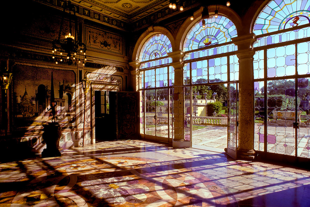 Palatial Ballroom With Wood Floors And Paneled Walls And