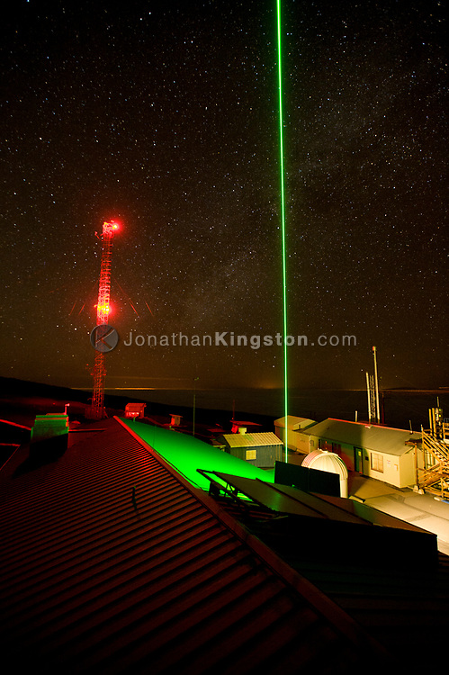 Green LIDAR laser shoots into the starry sky at the Mauna Loa Observatory, Hilo, Hawaii.