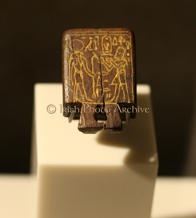 Plug of a sun dial: Amenhotep 111 in front of the Sun-god. New Kingdom 18th dynasty about 1360 BC ebony.